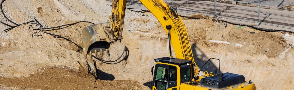 excavator on a construction site. excavator bucket with soil, gr